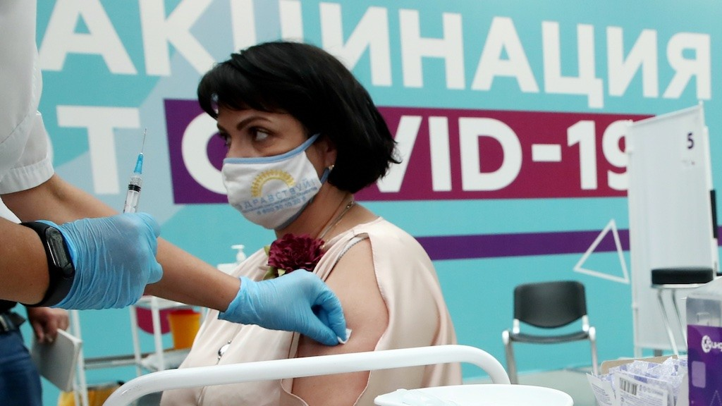 Photo: Irina Borovova, President of the Zdravstvui [Be Healthy] Interregional Association of Oncology Patients, visits the largest Russian COVID-19 vaccination site set up at the Gostiny Dvor Exhibition Centre, oncology patients also given injections. Credit: Anton Novoderezhkin/TASS.