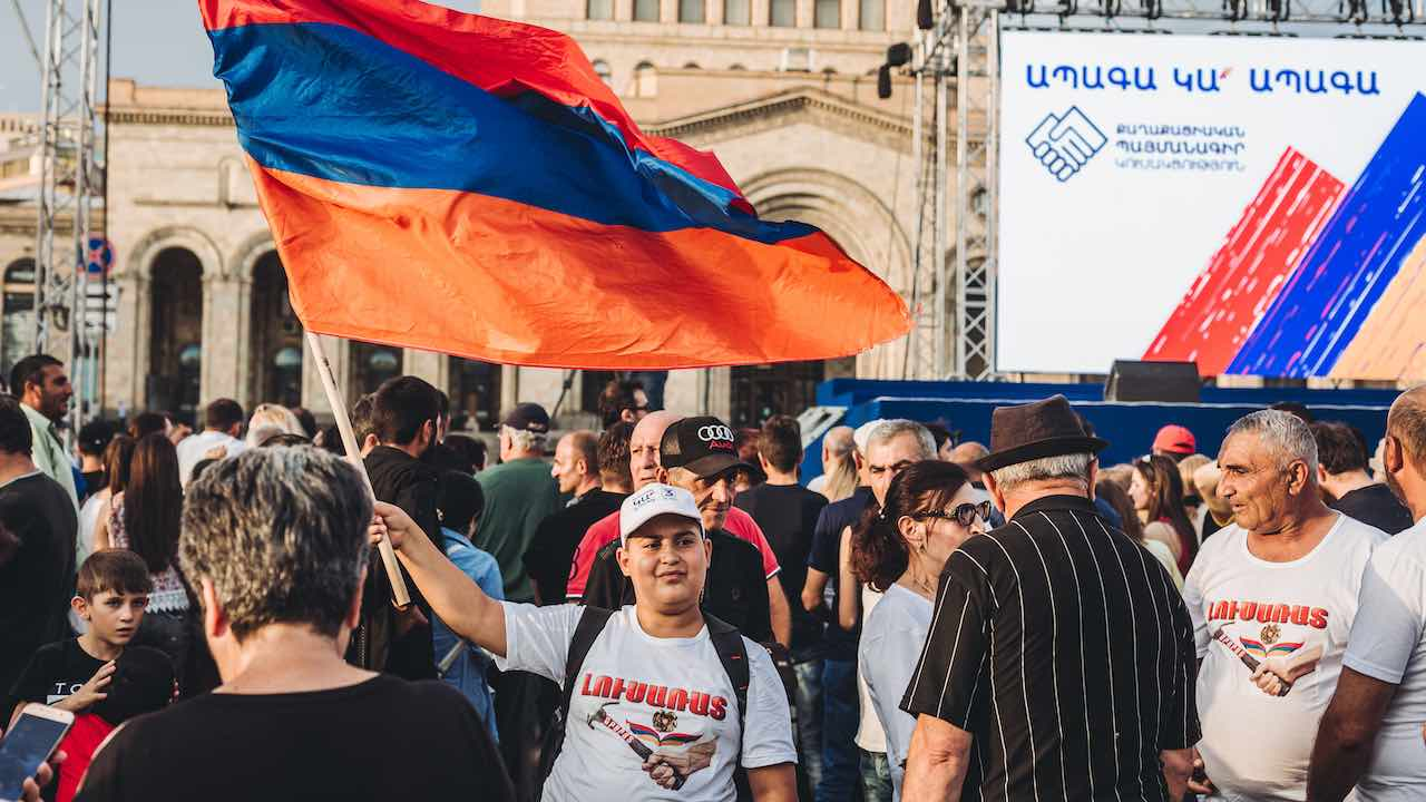 Photo: A supporter of Nikol Pashinian holds an Armenian flag during the victory celebration of Nikol Pashinyan in Armenia's parliamentary elections in Yerevan's Republic Square. Credit: Photo by Diego Herrera / SOPA Images/Sipa USA.