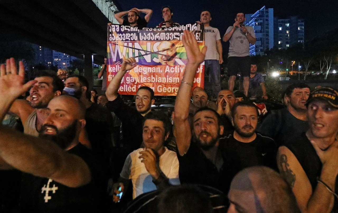 Photo: Protesters hold a banner depicting U.S. Ambassador to Georgia Kelly Degnan during a rally against Pride Week in Tbilisi, Georgia July 1, 2021. Credit: REUTERS/Irakli Gedenidze
