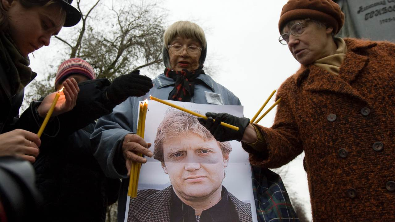 Photo: People light candles during a gathering commemorating the death of former Russian state security officer Alexander Litvinenko in central Moscow November 22, 2008. The former Russian agent Litvinenko died on November 23, 2006 after he was poisoned with highly radioactive Polonium 210. Credit: REUTERS/Thomas Peter