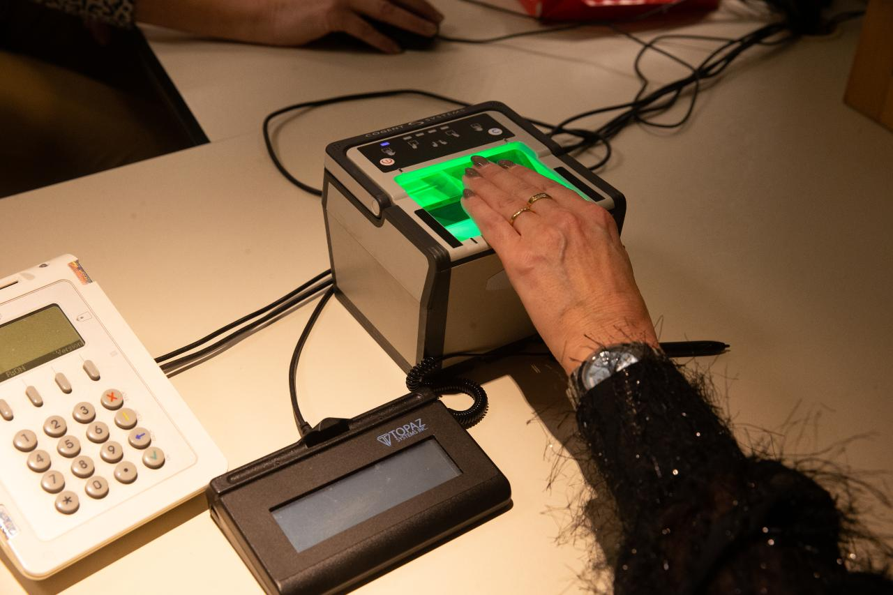Photo: Illustration picture shows a fingerprint scanning device during the launch of the new eID, electronic identity card, Tuesday 14 January 2020, in Lokeren. Credit: BELGA PHOTO Nicolas Maeterlinck.