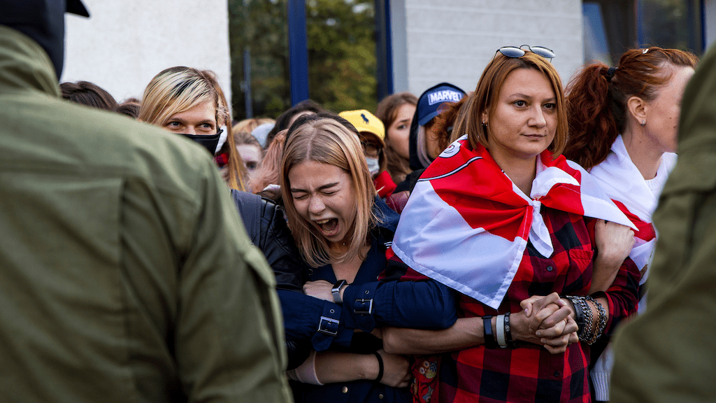 Photo: Women blocked by Belarusian law enforcement officers gather during an opposition rally to protest against police brutality and to reject the presidential election results in Minsk, Belarus September 19, 2020. Credit: BelaPAN via REUTERS