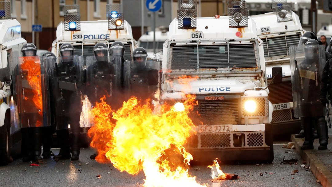 Photo: A fire burns in front of the police on the Springfield Road as protests continue in Belfast, Northern Ireland April 8, 2021. Credit: REUTERS/Jason Cairnduff TPX IMAGES OF THE DAY.