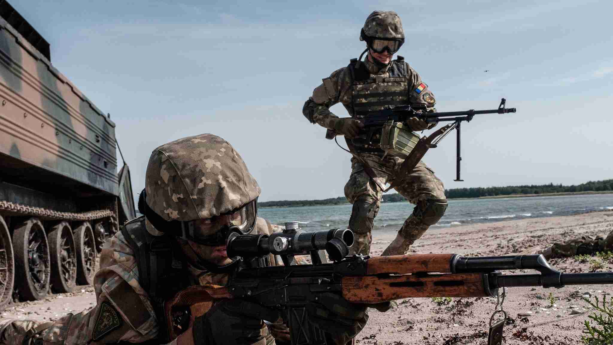 Photo: Romanian Marines storm a beach on Saaremaa Island in Estonia during BALTOPS 2019. An annual US-led exercise involving 16 NATO Allies and two partner nations, BALTOPS focuses on improving maritime interoperability through multinational amphibious operations in the Baltic Sea region. Credit: NATO