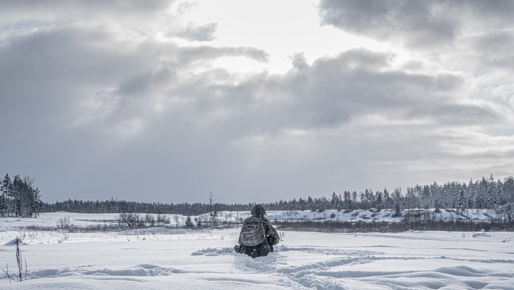 Photo: British soldier waits in the snow during cold weather training exercise in Estonia. Credit: NATO