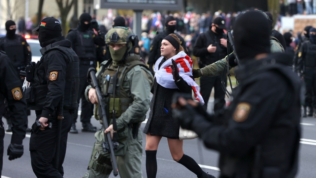 Photo: Riot police officers detain a participant in the Dziady opposition march in Independence Avenue. The annual march is held by the Belarusian opposition from central Minsk to Kurapaty, a mass burial site of victims of Stalinist repression, on the eve of Dziady, the day of remembrance of the deceased ancestors. Mass protests are held in Belarus since August 9, the 2020 presidential election. Credit: Stringer/TASS.