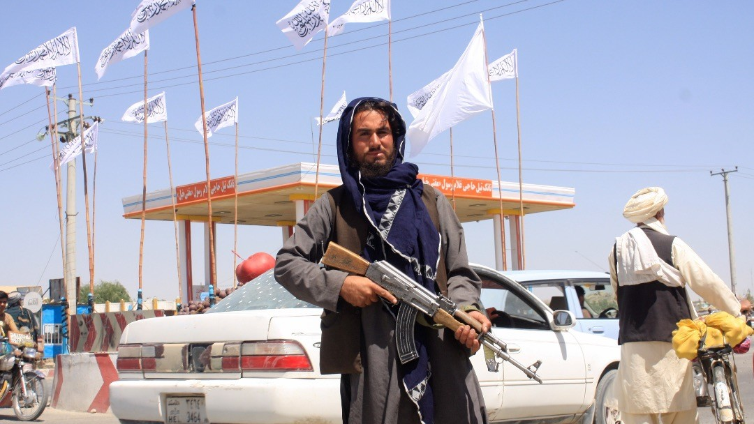 Photo: A Taliban fighter looks on as he stands at the city of Ghazni, Afghanistan August 14, 2021. Credit: REUTERS/Stringer