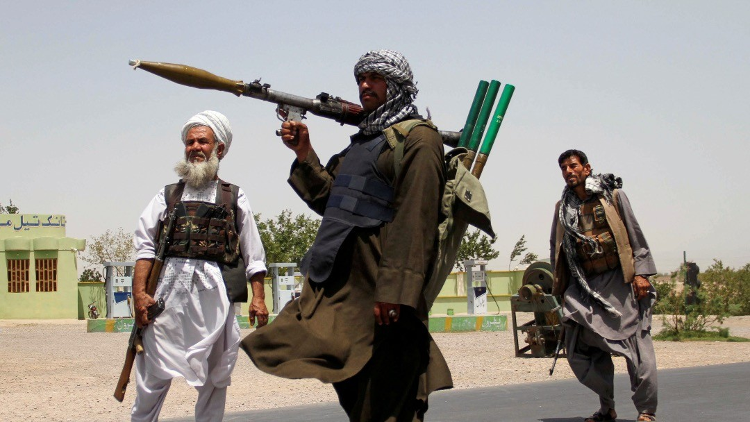 Photo: Former Mujahideen hold weapons to support Afghan forces in their fight against Taliban, on the outskirts of Herat province, Afghanistan July 10, 2021. Credit: REUTERS/Jalil Ahmad/File Photo.