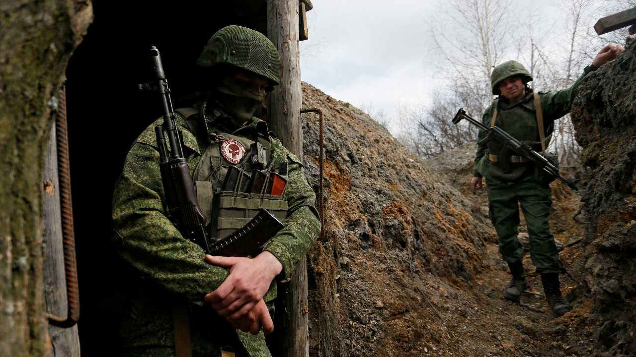 Photo: Militants of the self-proclaimed Luhansk People's Republic (LNR) stand guard at fighting positions on the line of separation from the Ukrainian armed forces in Luhansk Region, Ukraine April 13, 2021. Credit: REUTERS/Alexander Ermochenko