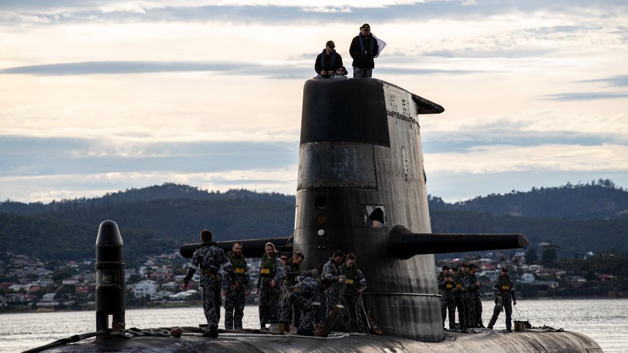 Photo: Royal Australian Navy submarine HMAS Sheean arrives alongside during a logistics port visit of Hobart, Tasmania. Credit: Royal Australian Navy/ LSIS Leo Baumgartner