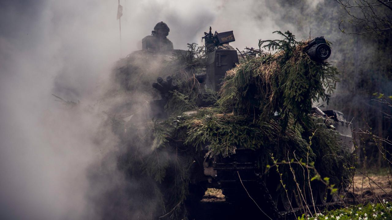 Photo: A British Army Challenger 2 Main Battle Tank (MBT) lays down a smoke screen during Spring Storm 19, Estonia's largest annual military exercise. Roughly 9,000 soldiers from Estonia, other NATO Allies and partner nations have gathered near the town of Jõhvi to engage in a collective defence exercise, strengthening their ability to work together in times of crisis. Credit: NATO