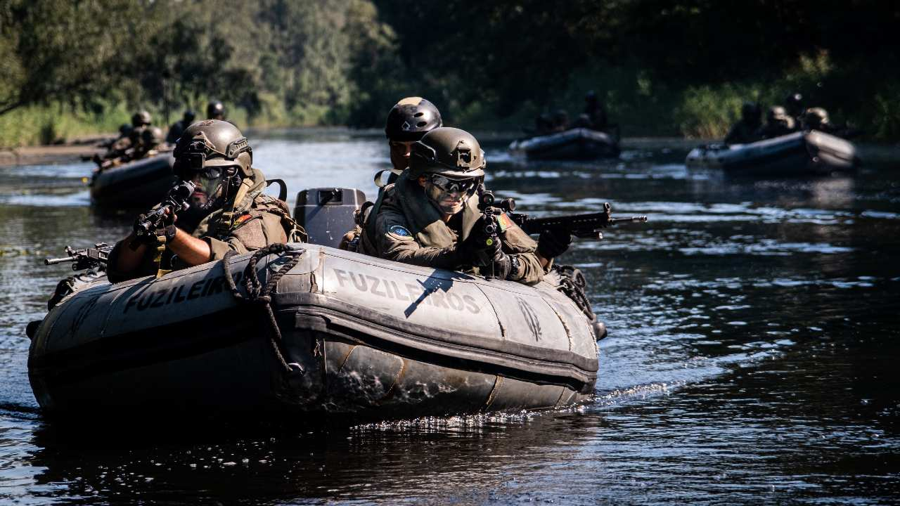 Photo: Portuguese marines train in Lithuania For the Portuguese Fuzileiros, stealth can be key to securing their objectives. Using light Inflatable boats, or LIBs, Recon teams move quietly by water, keeping as low a profile as possible.     Portuguese marines (the Fuzileiros) and navy divers have been practising skills and tactics in Lithuania. The group is in the Baltic country for three months as part of NATO assurance measures which comprise land, sea and air activities in, on and around the eastern part of NATO's Alliance. Credit: NATO