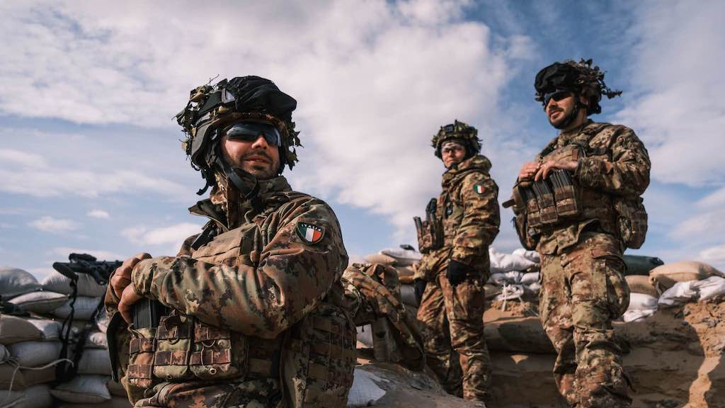 Image: Italian soldiers relax during a break in the action during Exercise Steele Crescendo. Credit: NATO.
