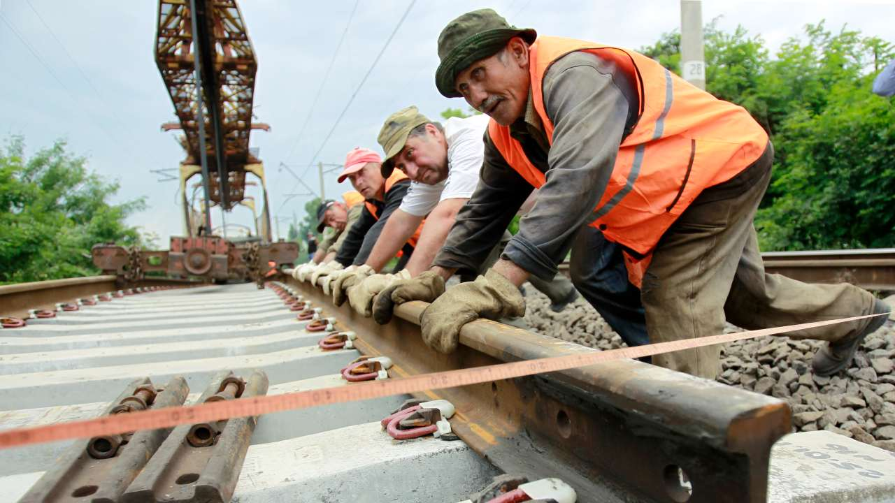 Photo: Workers install railway tracks near the settlement of Kaspi, some 50 km west of Tbilisi, June 7, 2012. Georgia postponed a planned London listing of its state railways monopoly in May, dealing a fresh blow to IPO markets as investors struggle with volatile share prices and reel from the debacle of Facebook's flotation. Credit: REUTERS/David Mdzinarishvili