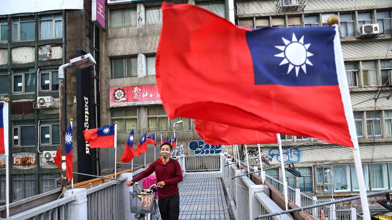 Photo: A man walks on an overpass decorated with Taiwan flags to celebrate the upcoming National Day in Taipei, Taiwan, October 7, 2021. Credit: REUTERS/Ann Wang