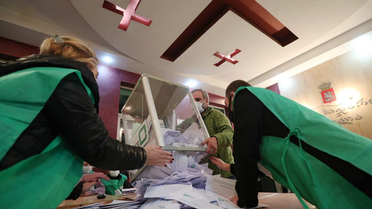 Members of a local election commission empty a ballot box before counting votes during the municipal elections in Tbilisi, Georgia October 2, 2021. REUTERS/Irakli Gedenidze