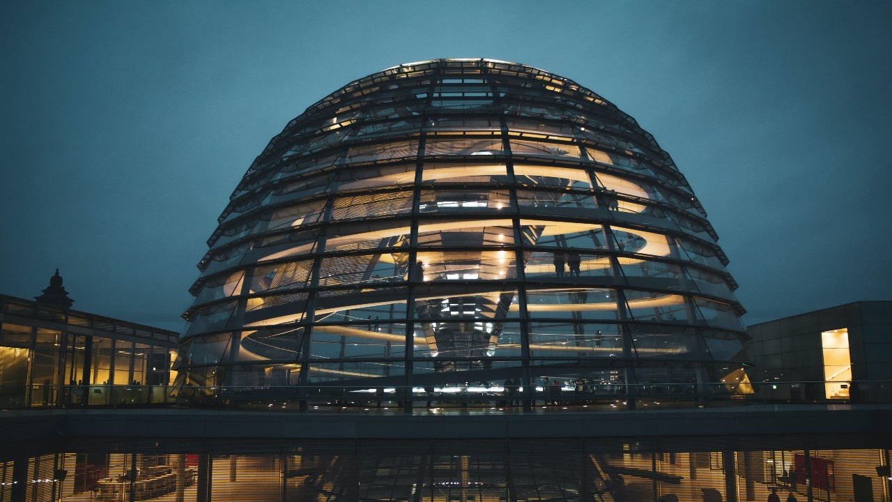 Photo: Dome of the German Bundestag on top of the Reichstag. Credit: Christian Lue / Unsplash
